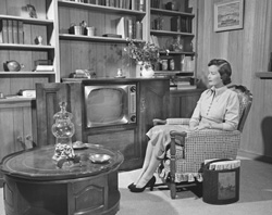 Woman sitting in front of TV